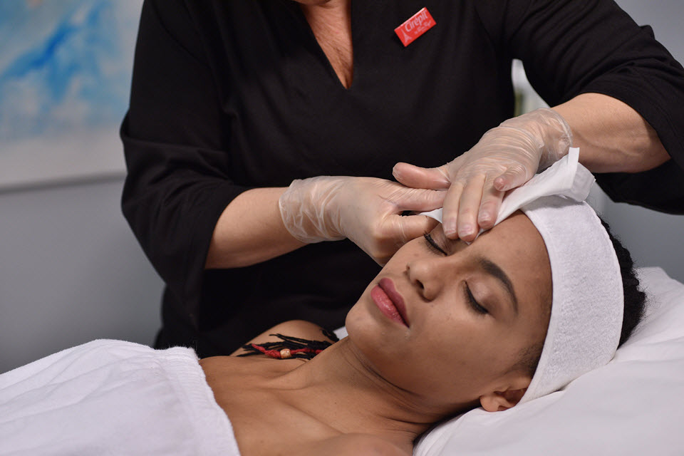 Woman getting eyebrows waxed | SalonCentric
