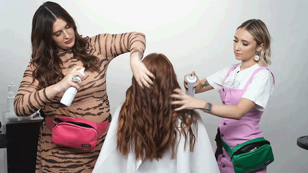 Two women brushing out the curls with their hands | SalonCentric