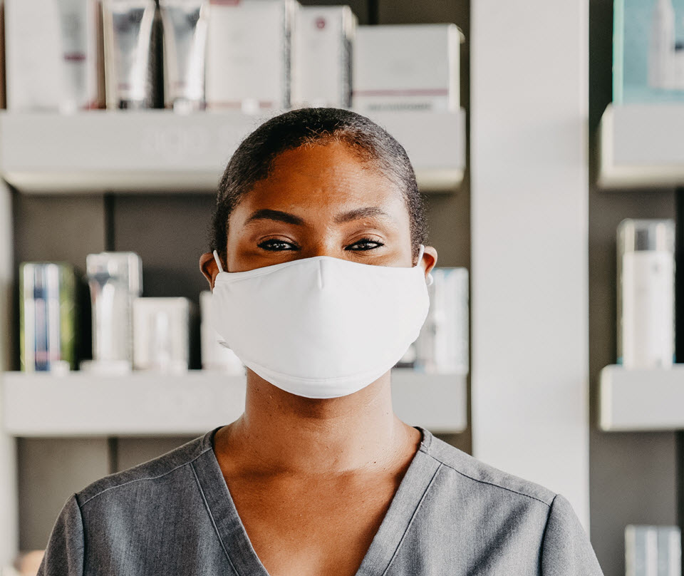 Skincare therapist wearing a mask | SalonCentric
