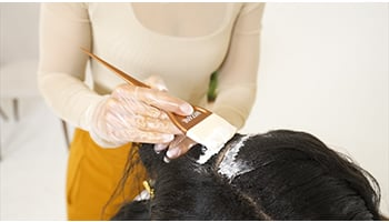 Relaxer-being-applied-to-hairline-step-by-step-tutorial-evie-johnson