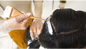 Relaxer-being-applied-to-hair-step-by-step-tutorial