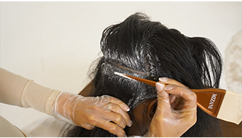 Relaxer-being-smoothed-blended-into-hair-step-by-step-tutorial